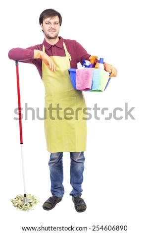 Full length portrait  of young man with apron holding cleaning equipment  over white background - stock photo