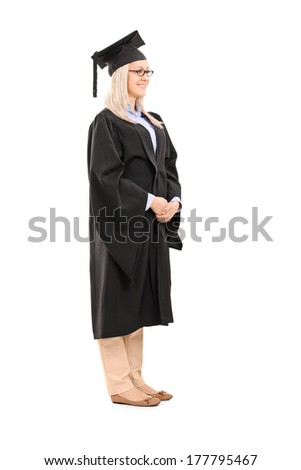 Full length portrait of young woman in graduation gown isolated on white background