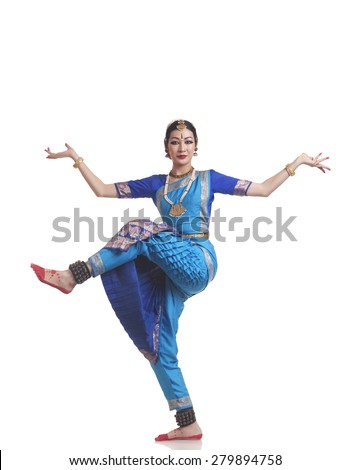 Full length portrait of young woman performing Bharatanatyam over white background - stock photo