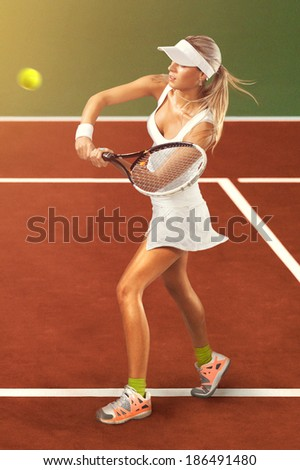 Full length portrait of young woman playing tennis on a dross field. Healthy lifestyle - stock photo