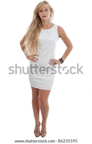 Full-length portrait of young woman wearing in short white dress - stock photo