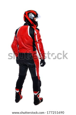 full length portrait on white of motorcyclist in red equipment view from behind - stock photo