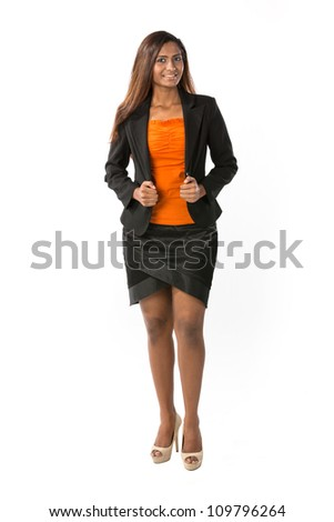Full length Portrait Portrait of a happy Indian business woman. Isolated on a white background. - stock photo