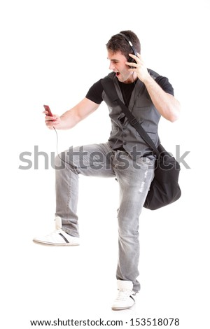 Full length portrait school boy phone isolated on white running while listening to music - stock photo
