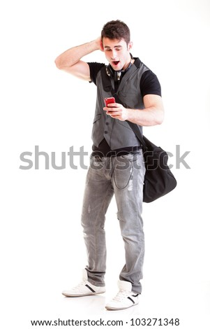 Full length portrait school boy phone isolated on white surprised teenager get sms - stock photo