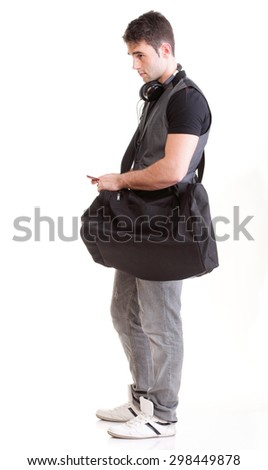 Full length portrait school boy with mobile phone and headphones isolated on white - stock photo