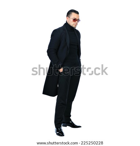 Full length portrait sexy man in black coat isolated on white  - stock photo
