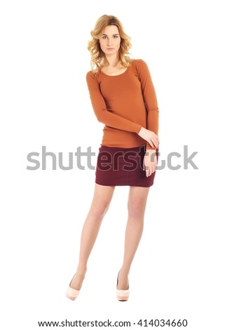 Full-length portrait young woman in skirt - stock photo