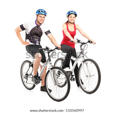 Full length portraits of young male and female bikers on a bike isolated on white background
