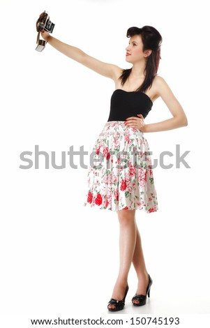 Full length pretty retro summer girl taking picture using vintage camera white background