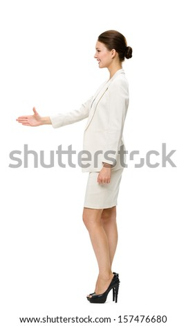 Full-length profile of business woman handshaking, isolated on white. Concept of leadership and success - stock photo