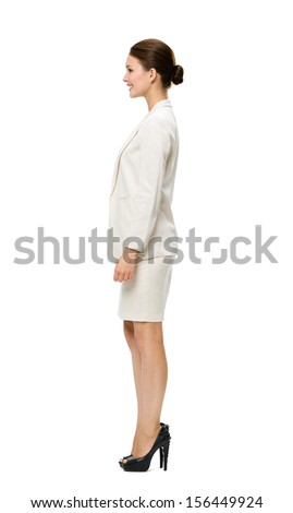 Full-length profile of businesswoman, isolated on white. Concept of leadership and success - stock photo