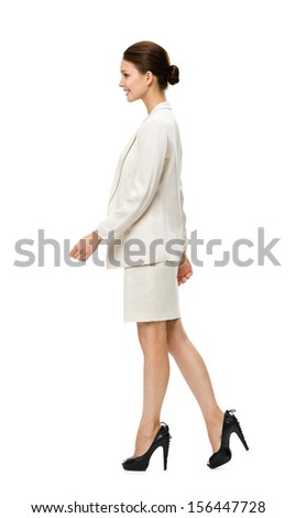 Full-length profile of walking businesswoman, isolated on white. Concept of leadership and success - stock photo