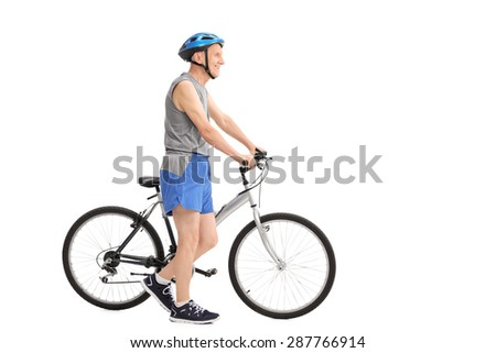 Full length profile shot of an active senior man pushing a bike isolated on white background