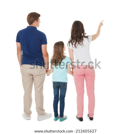 Full length rear view of woman showing something to family over white background