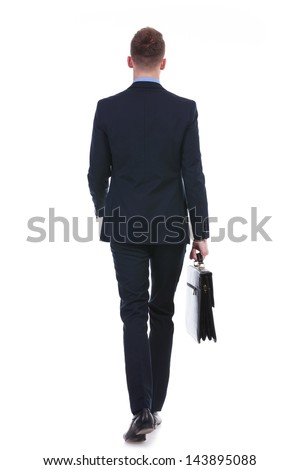 full length rear view picture of a young business man walking away from the camera with a suitcase in his hand. on white background - stock photo