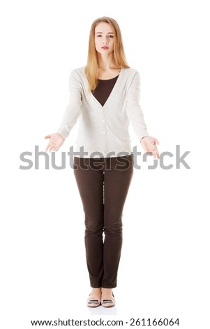 Full length sad woman with open hands gesture. - stock photo