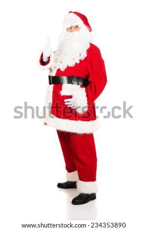 Full length Santa Claus gesturing ok sign. - stock photo