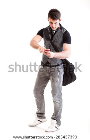Full length school boy using phone isolated on white, teenager get sms - stock photo