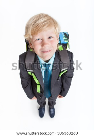 Full-length schoolboy with school backpack on back, isolated on white background - stock photo