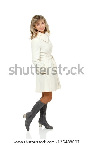 full length seasonal portrait of mid adult woman, attractive caucasian 40 years old woman in coat over white