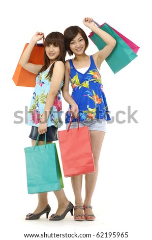 full-length shopping asian young woman - stock photo