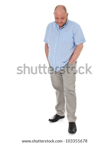 Full length shot of a adult man looking down. All on white background.
