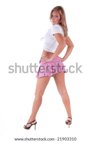 Full length shot of a beautiful blond woman wearing a cute pink skirt and a white shirt.