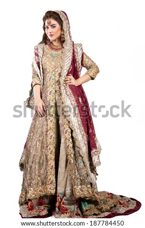 full length shot of a beautiful muslim indian bride - stock photo