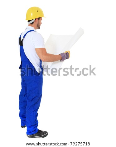Full length shot of a construction worker studying construction plan. All on white background. - stock photo