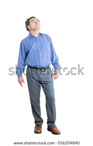 Full Length Shot of a Pensive Middle-Aged Office Man Looking Up High Against White Background. - stock photo