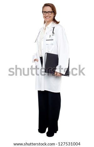 Full length shot of a physician holding medical file. - stock photo
