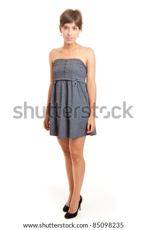 full length shot of a young girl in blue dress, isolated on white