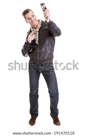Full length shot of a young taking a selfie with his modern smart phone  - isolated on white background - stock photo