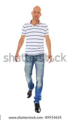 Full length shot of an attractive man walking. All on white background. - stock photo