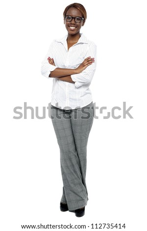 Full length shot of attractive female consultant. Arms folded and legs crossed - stock photo
