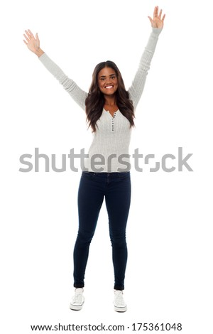 Full length shot of excited beautiful woman - stock photo