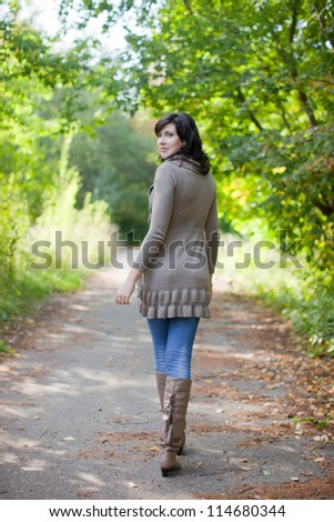 Full length shot of girl  in september park - stock photo