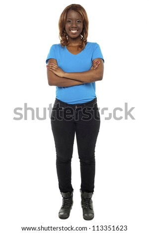 Full length shot of gorgeous african teenager posing with her arms crossed