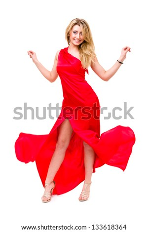Full length shot of sexy woman in red dress, isolated on white background - stock photo