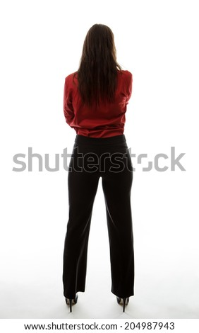 full length shot of the behind of a woman looking at something
