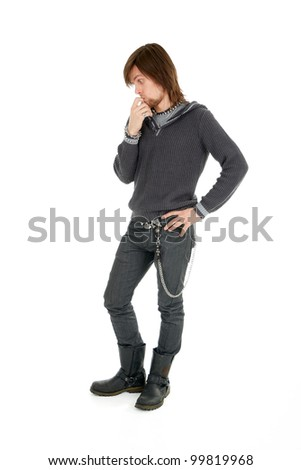 Full length shot of thoughtful man looking down with silly expression - stock photo