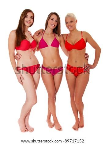Full length shot of three beautiful young women in bikini. All on white background. - stock photo
