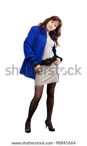 full length shot of woman in blue coat on white background - stock photo