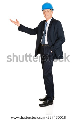 Full length side view businessman showing copyspace. - stock photo