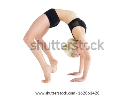 Full length side view of a fit young woman doing the wheel pose over white background - stock photo
