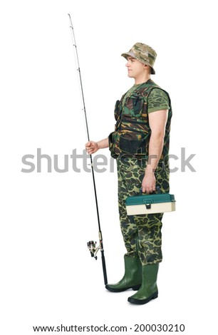 Full length side view portrait of a young fisherman in camouflage holding a fishing equipment isolated on white background - stock photo