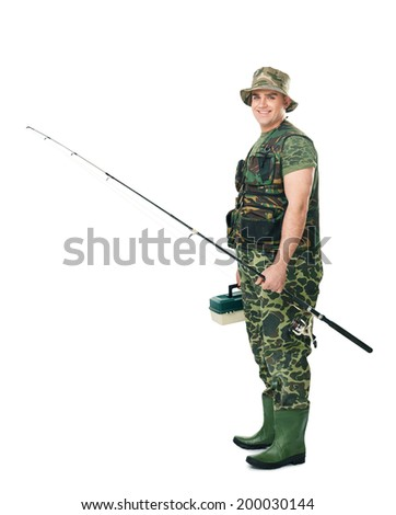 Full length side view portrait of a young happy smiling fisherman in camouflage holding a fishing equipment isolated on white background - stock photo