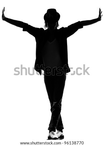 full length silhouette of a young man dancer dancing funky hip hop rb on isolated studio