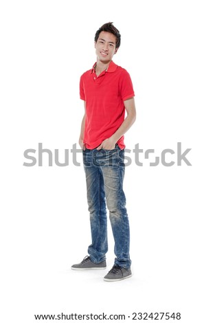 Full length smiley guy in red t-shirt and jeans. isolated on white - stock photo
